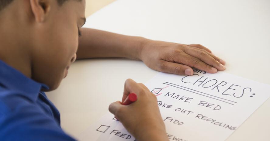 A photo of a boy checking a list