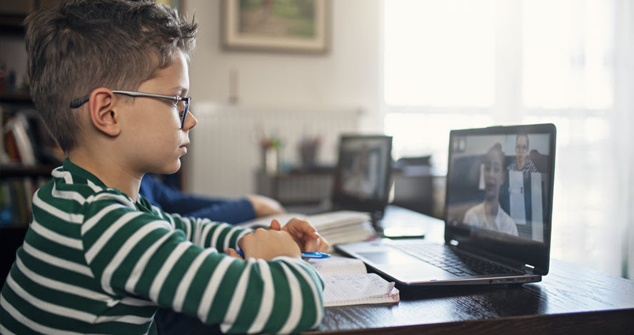 Photo of a boy on a computer