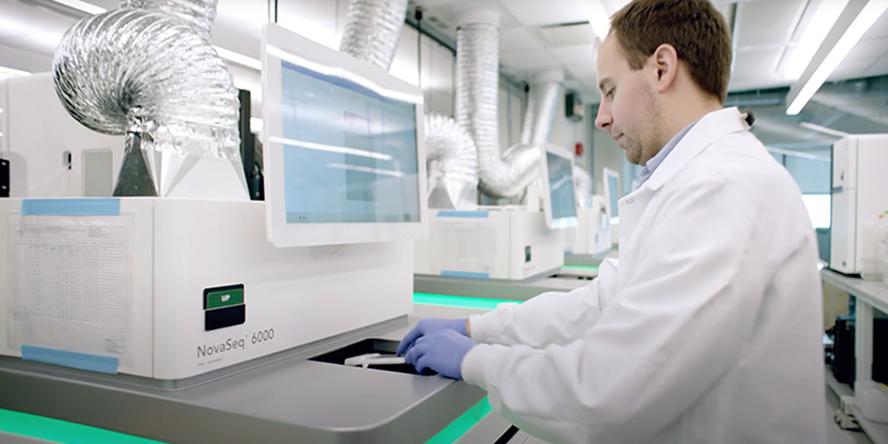 This photo shows a person using a gene  sequencing device.