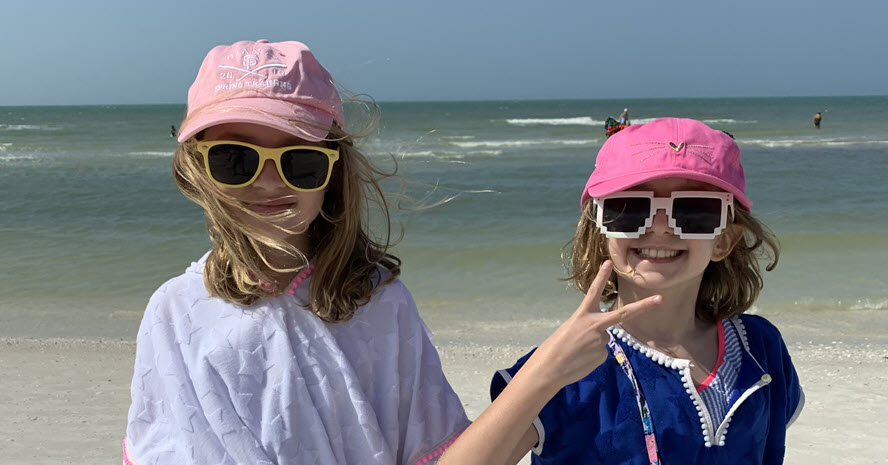 photo of two girls at the beach