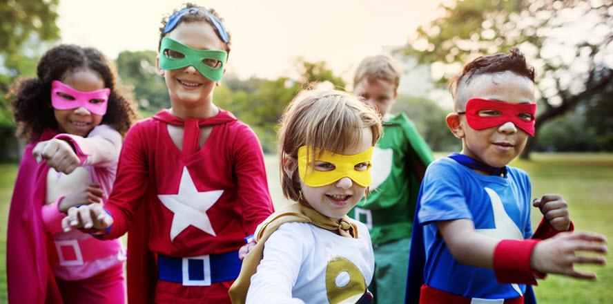 photo of children dressed as superheros
