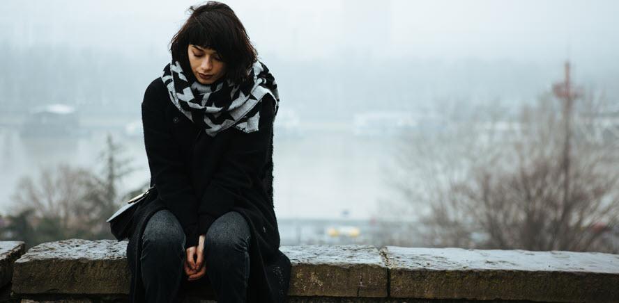 A photo of a sad woman